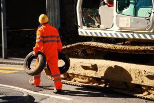 workerandtheexcavator.jpg